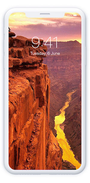 Image of a phone with canyon in background